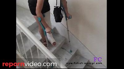 Fetisch-Concept.com - On stairs and outdoor with cast leg -