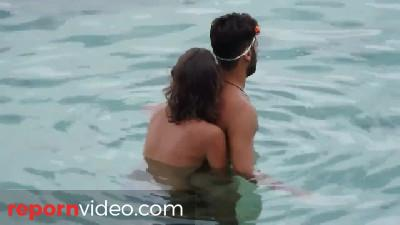 Young Couple Gets Caught Fucking on the Beach - Part 1: Handjob under Water